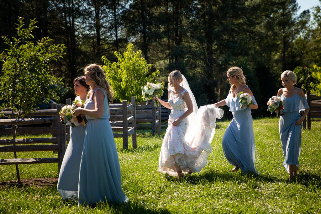 bride-walking-in-grass-the-star-barn